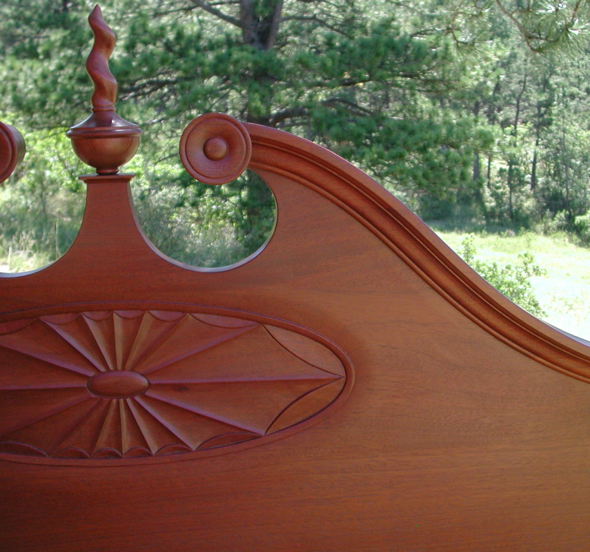 18th century four poster bed detail of the sunburst on the headboard