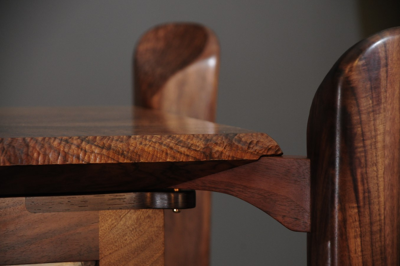 Detail of chip carved top and bridge to legs