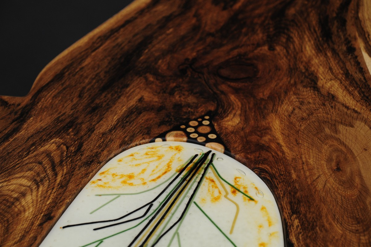 The detail of the fused glass and scrub oak inlay